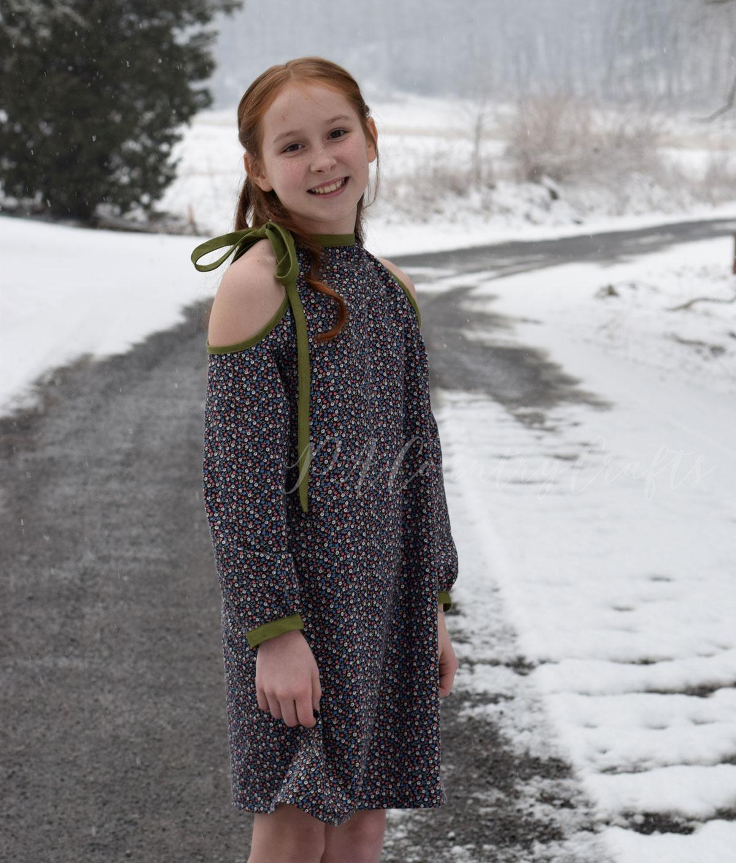 Cold shoulder slim fit dress with a shoulder tie accent