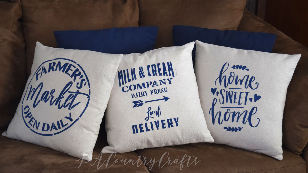 Farmhouse pillows made with drop cloth and stencils!