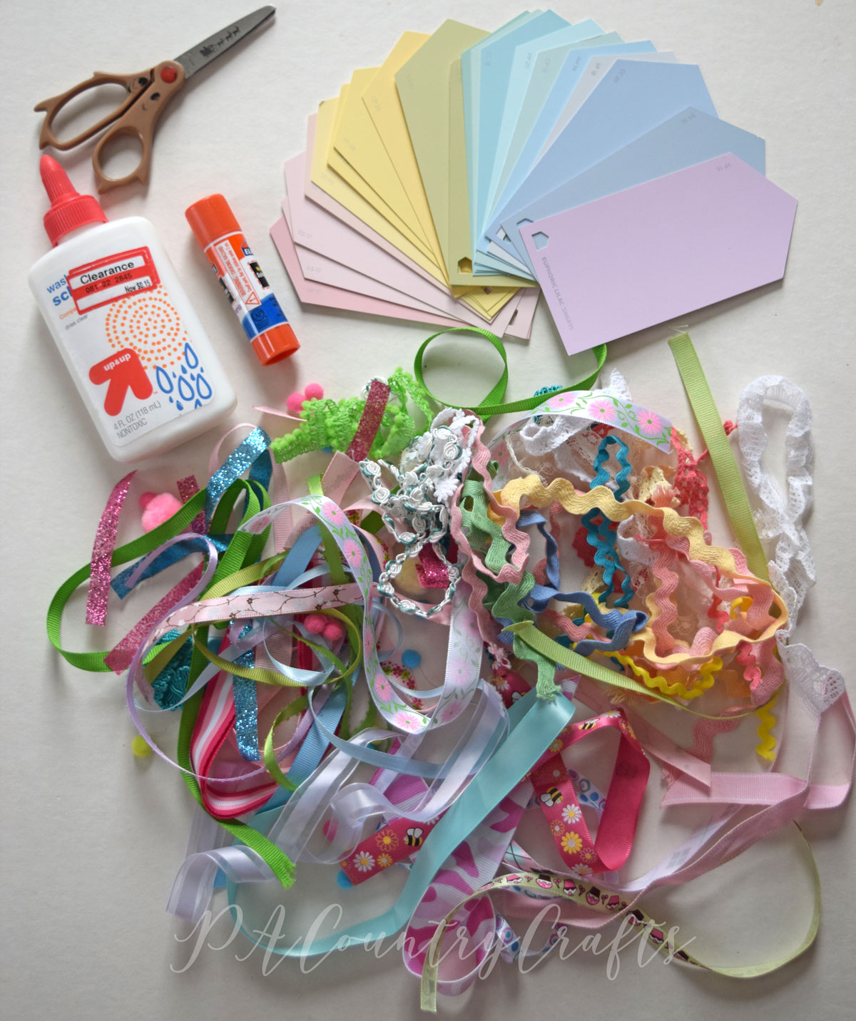 Busy bag Easter egg preschool craft idea using paint chips and ribbon scraps