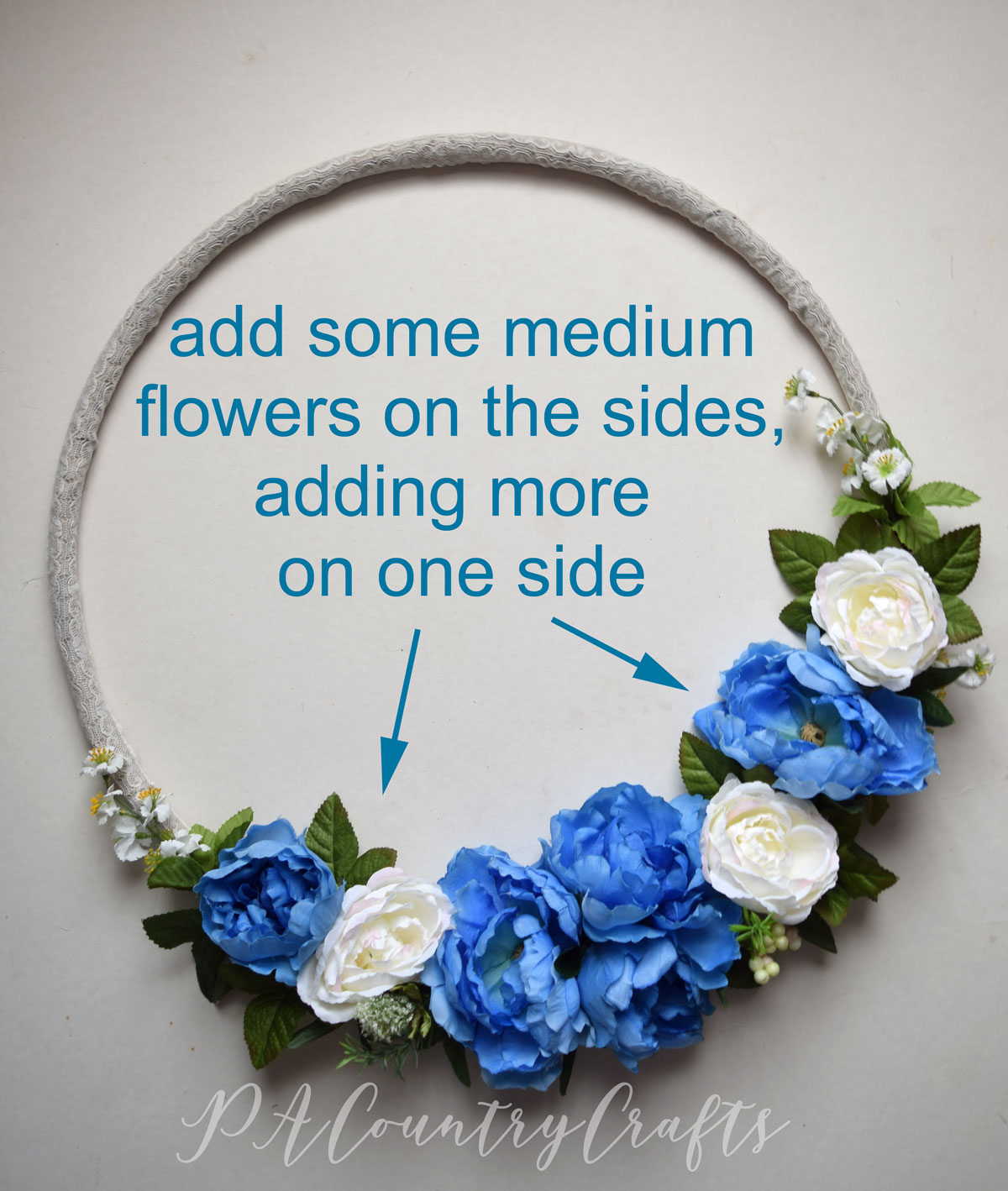 adding-flowers-to-a-hoop-wreath.jpg