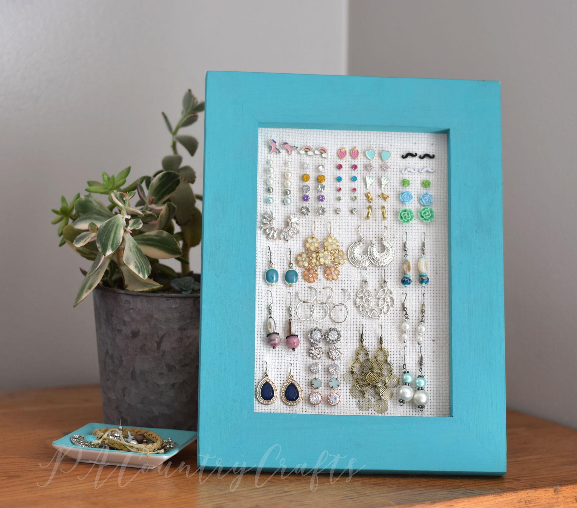 Make an easy frame earring holder to keep earrings organized!