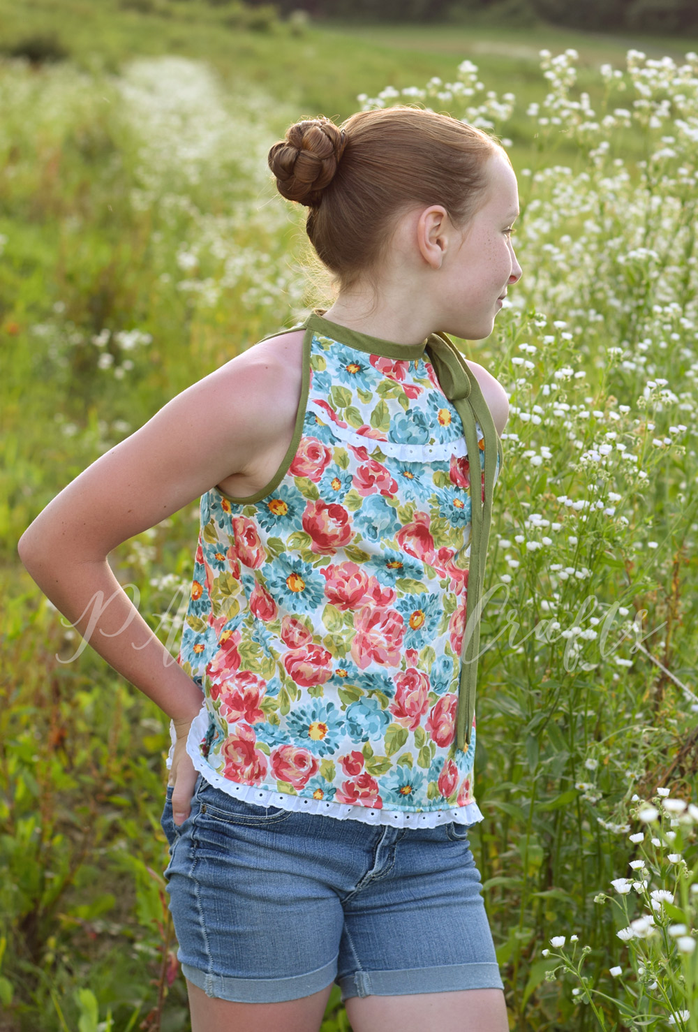 High neck, tie shoulder girls tank top made from Sofiona Designs' Lynx pattern.