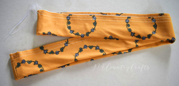 - 4. Sew two rows of gathering stitches along the top edge of the ruffle. Mark the centers of each piece of the ruffle.
