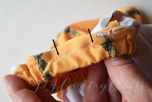 - 12. Sew the opening of the waistband closed to conceal the elastic. Finish seams if desired.