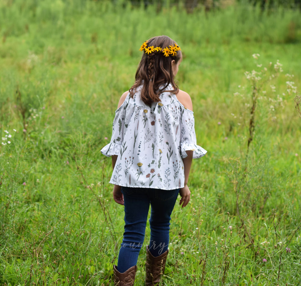I love this boho style girls shirt in a floral fabric designed for kids!