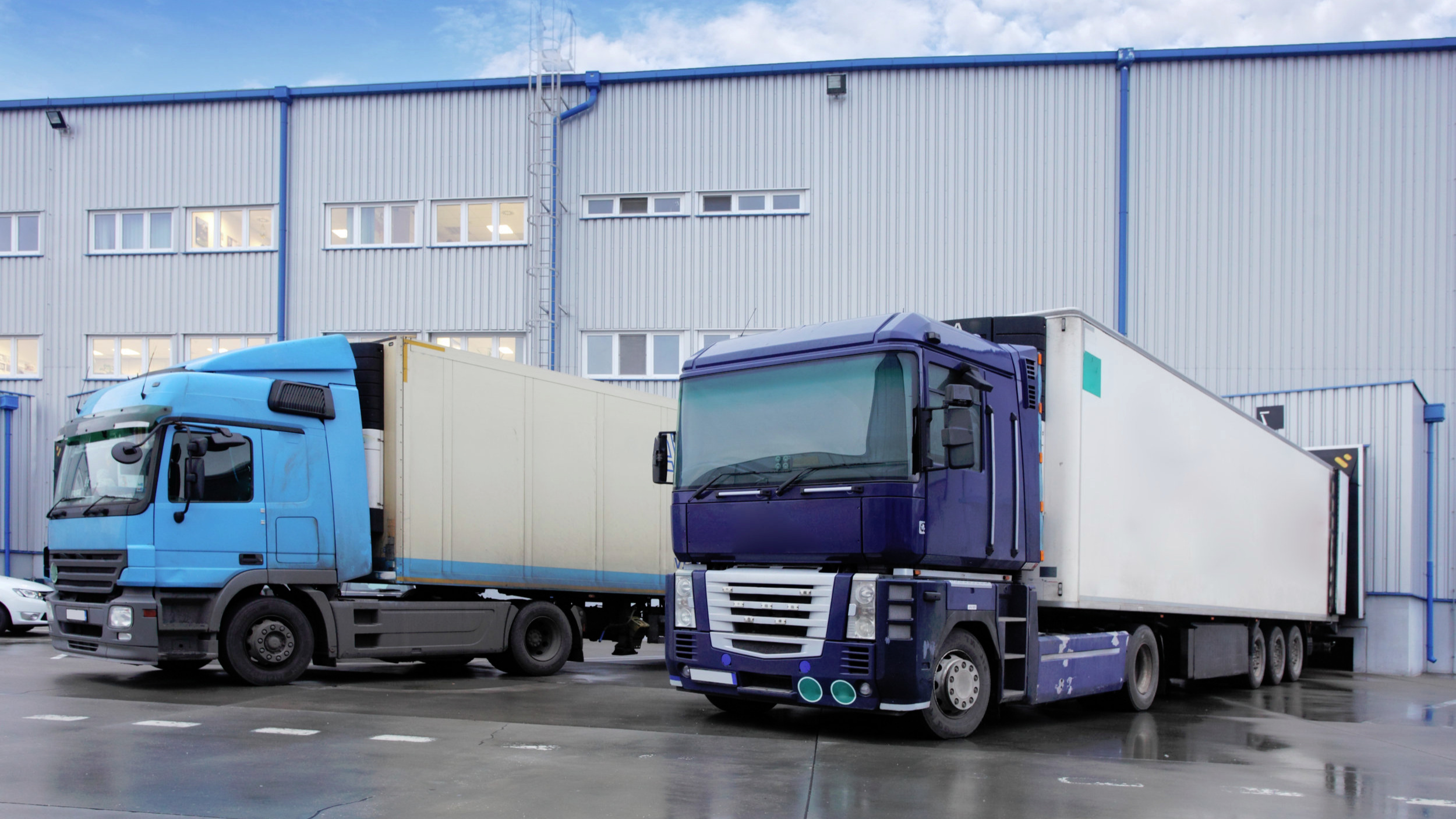 Canva+-+Freight+Transportation+-+Truck+in+the+warehouse-2.jpg