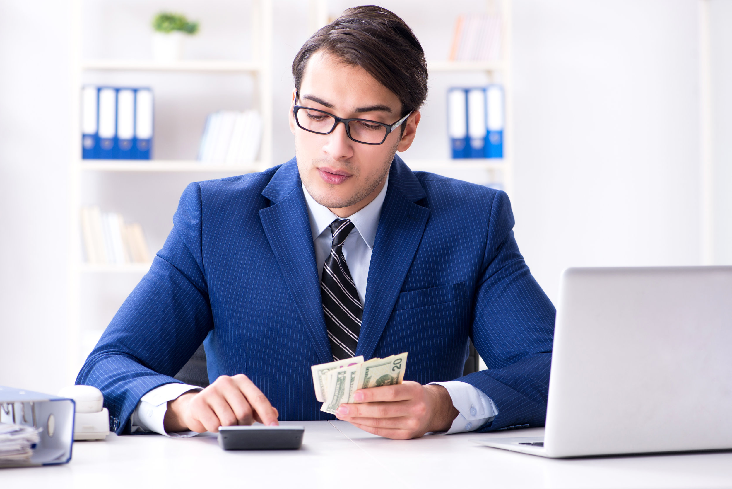 Canva - Accountant Calculating Dollars with Calculator in Office-1.jpg