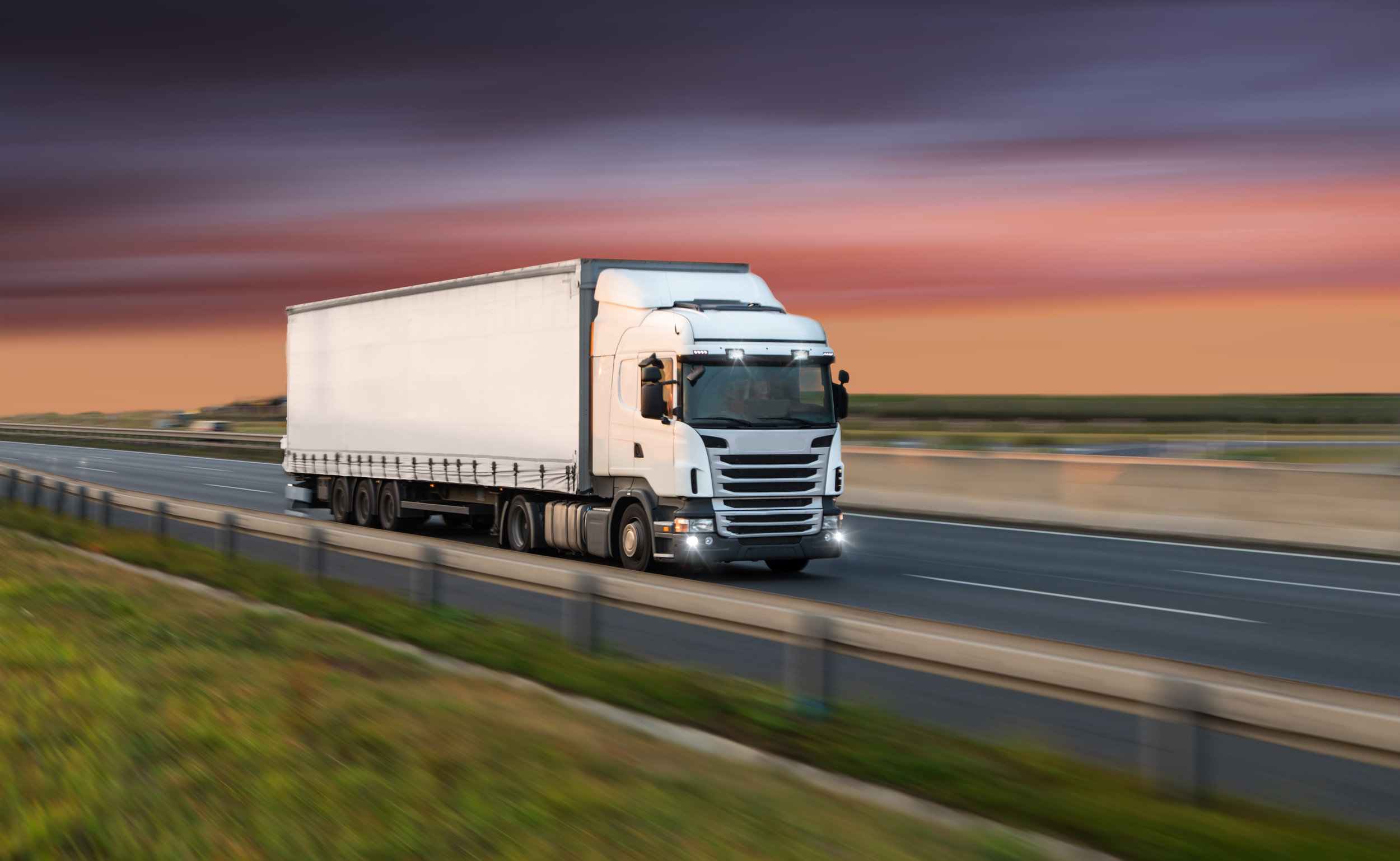 Canva - Truck with container on road, cargo transportation concept..jpg