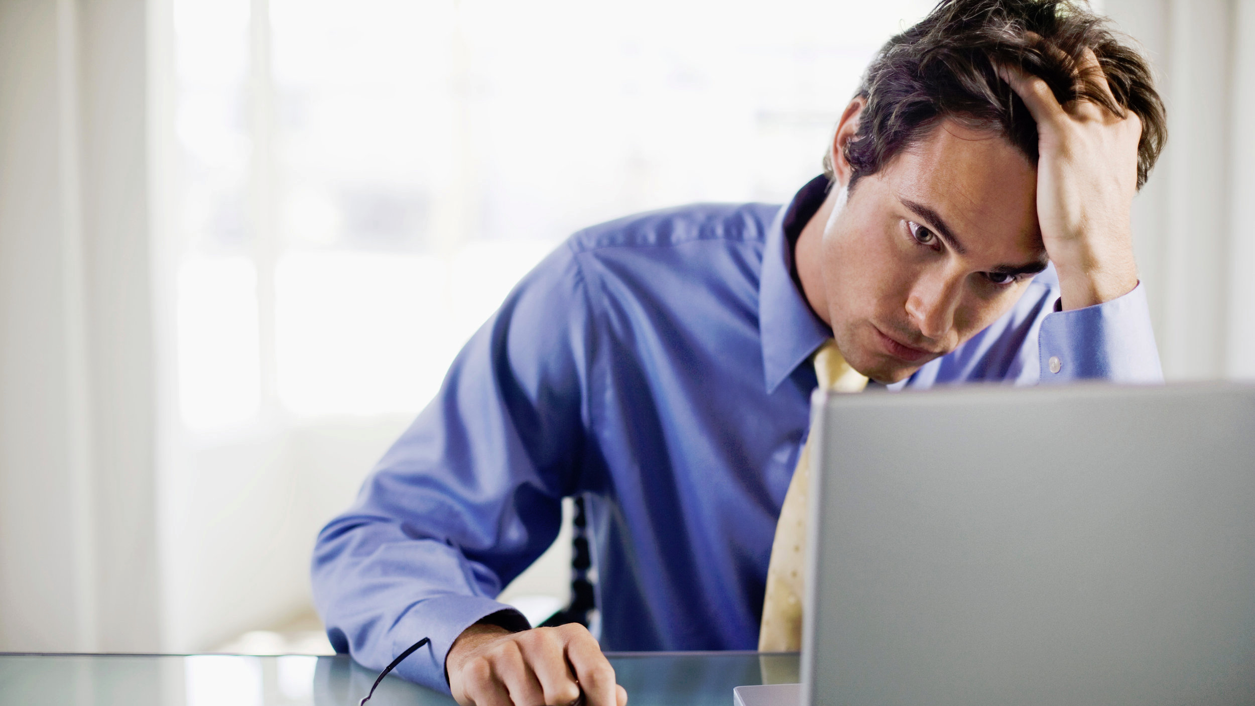 Canva+-+Frustrated+businessman+with+laptop+computer.jpg
