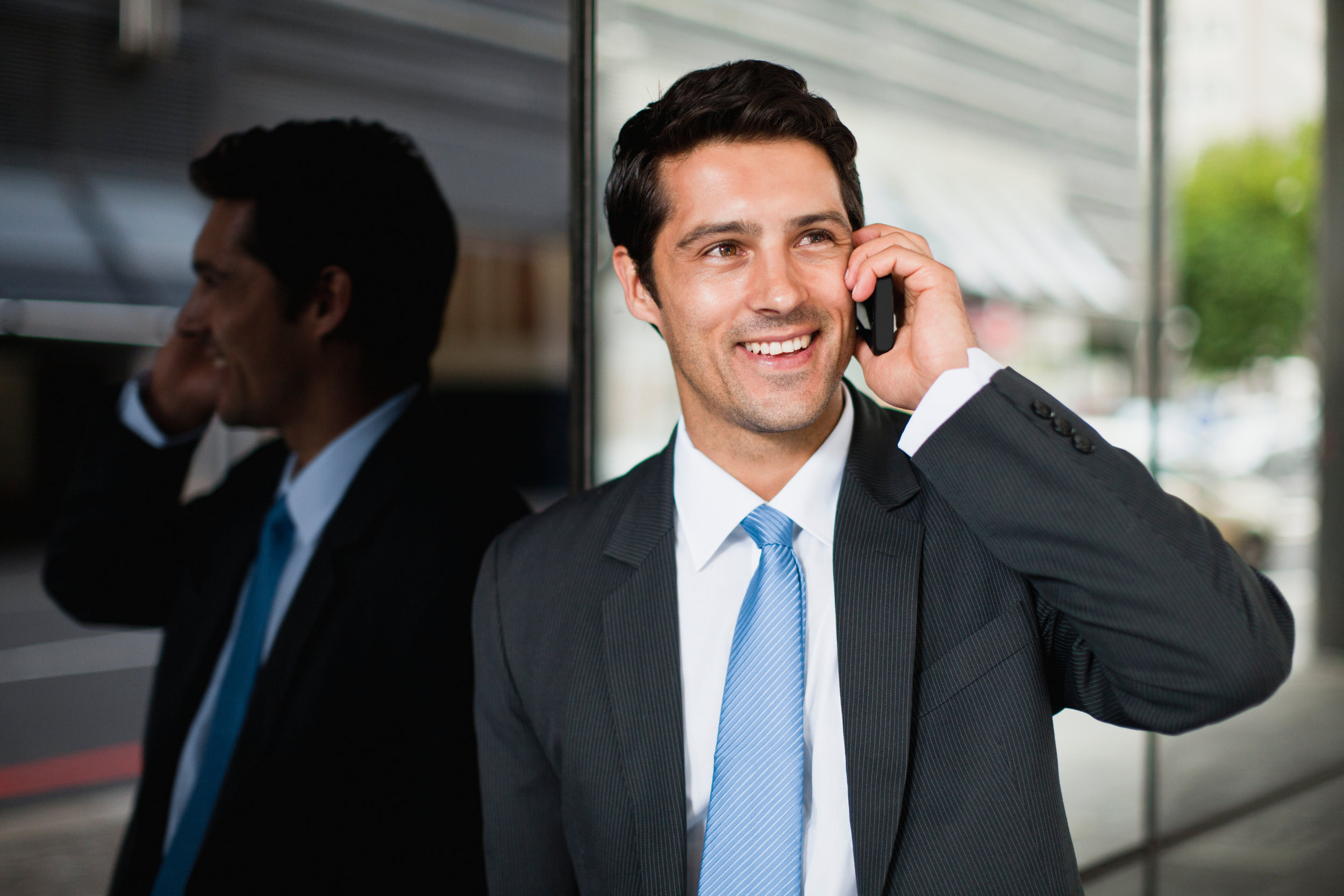 Canva - Businessman talking on cell phone.jpg