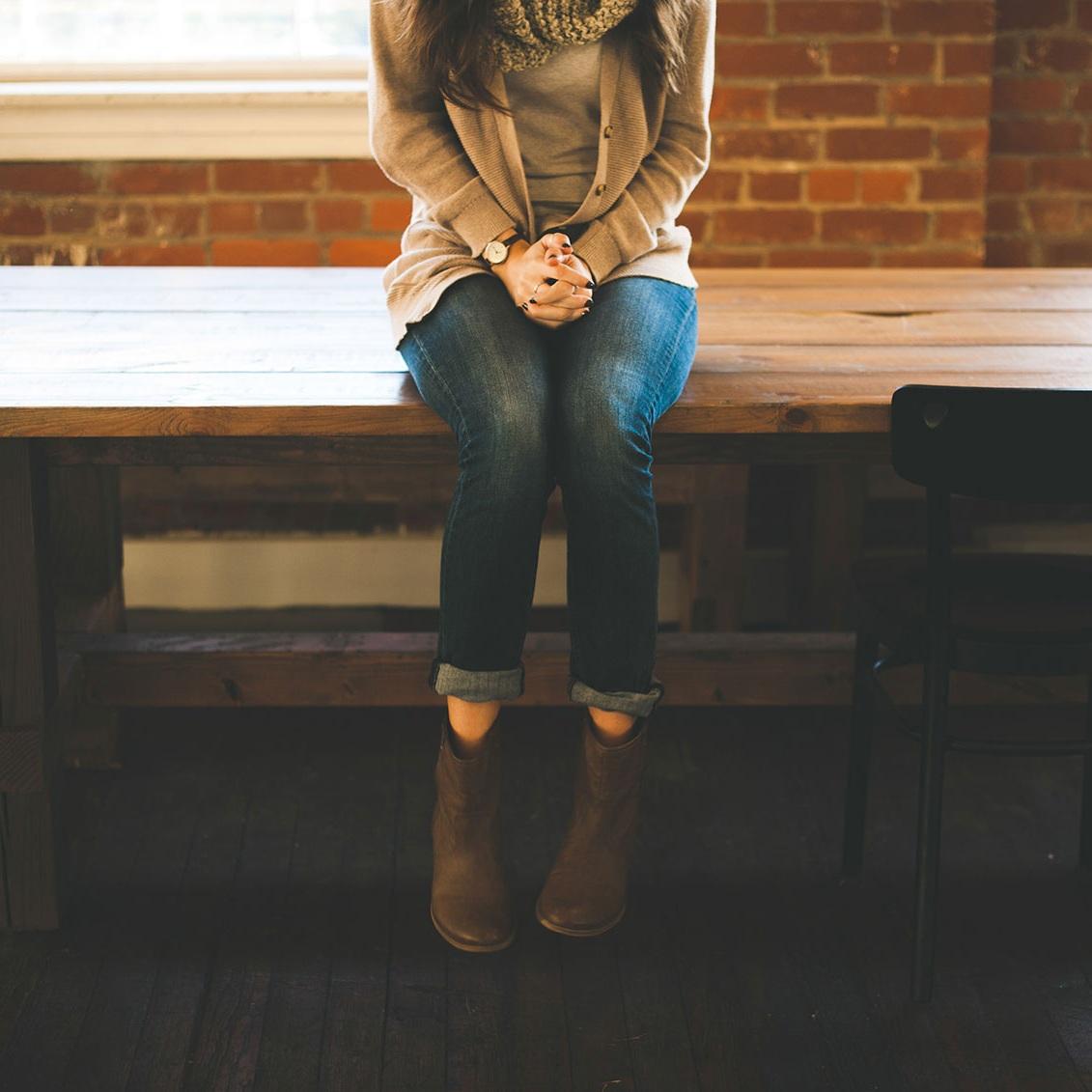woman-sitting-on-table-stocksnap.jpg