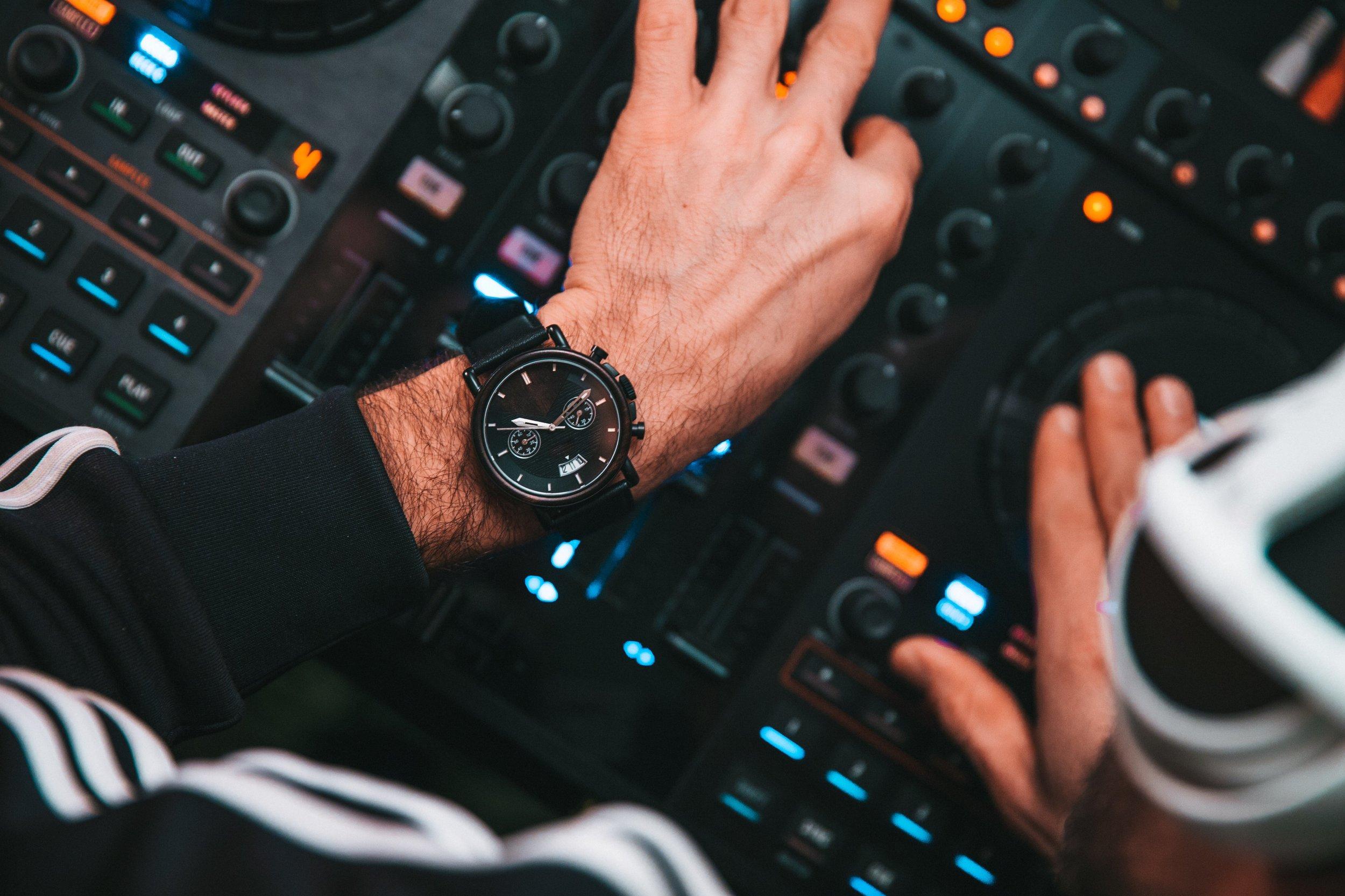 dj-hands-on-buttons_4460x4460.jpg