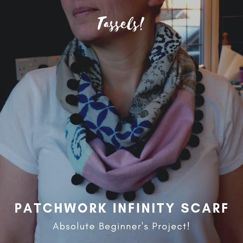 Infinity scarf with pompom trim