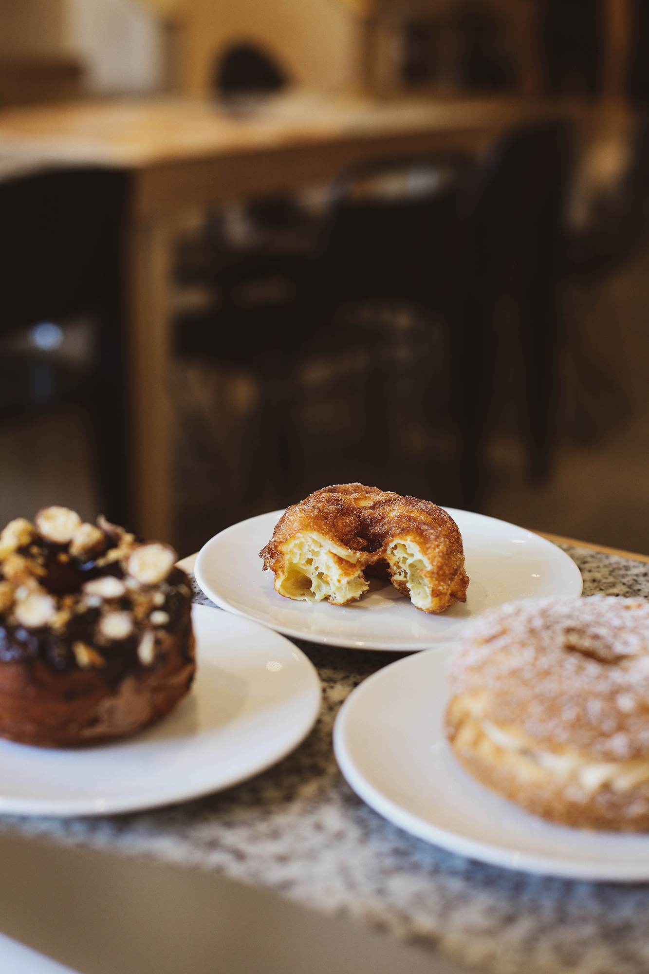 chocolate malt cronut, cinnamon cruller (focus), paris brest