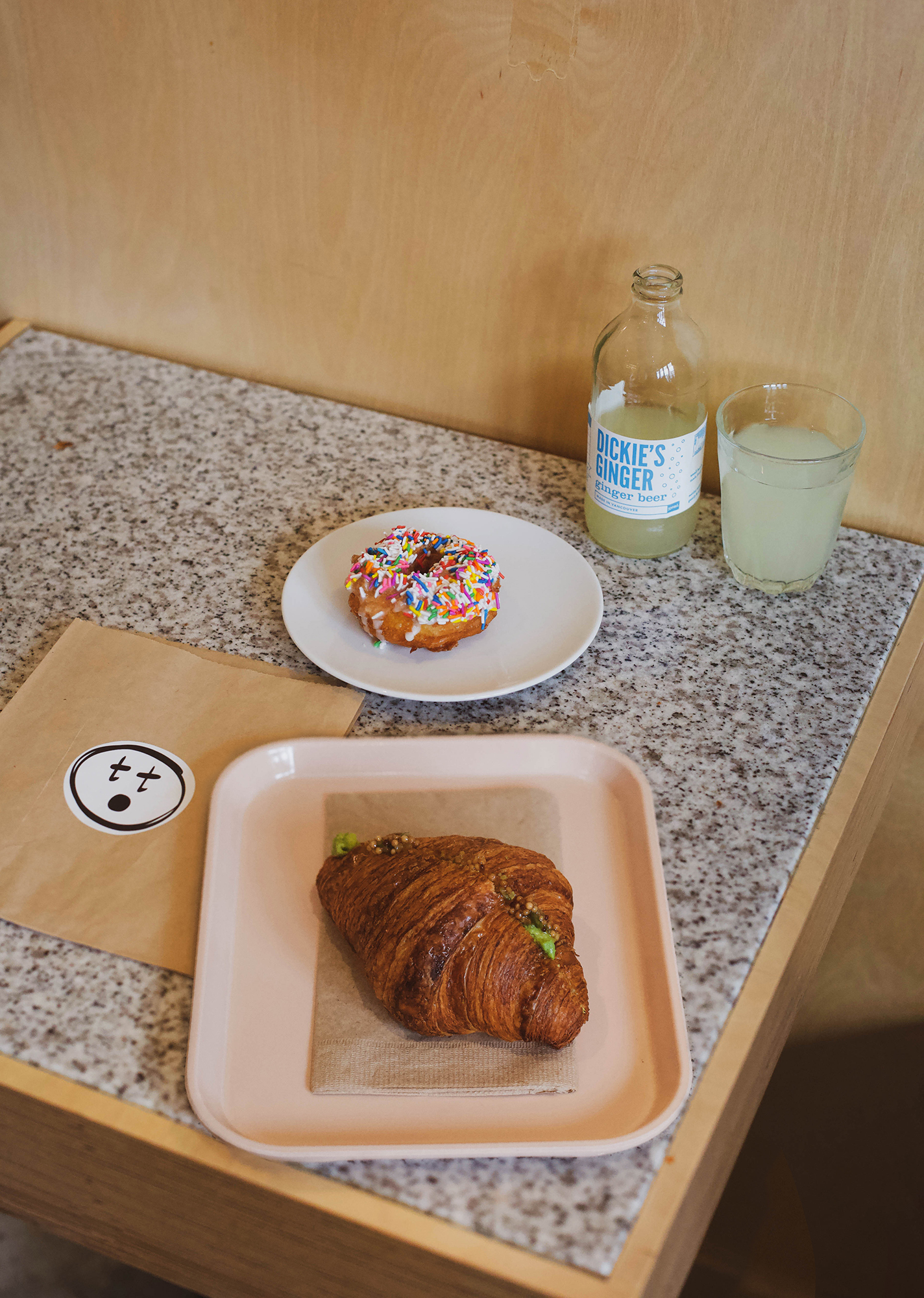 avocado croissant with pickled mustard seed, a confetti cruller, and locally brewed  dickie's ginger beer