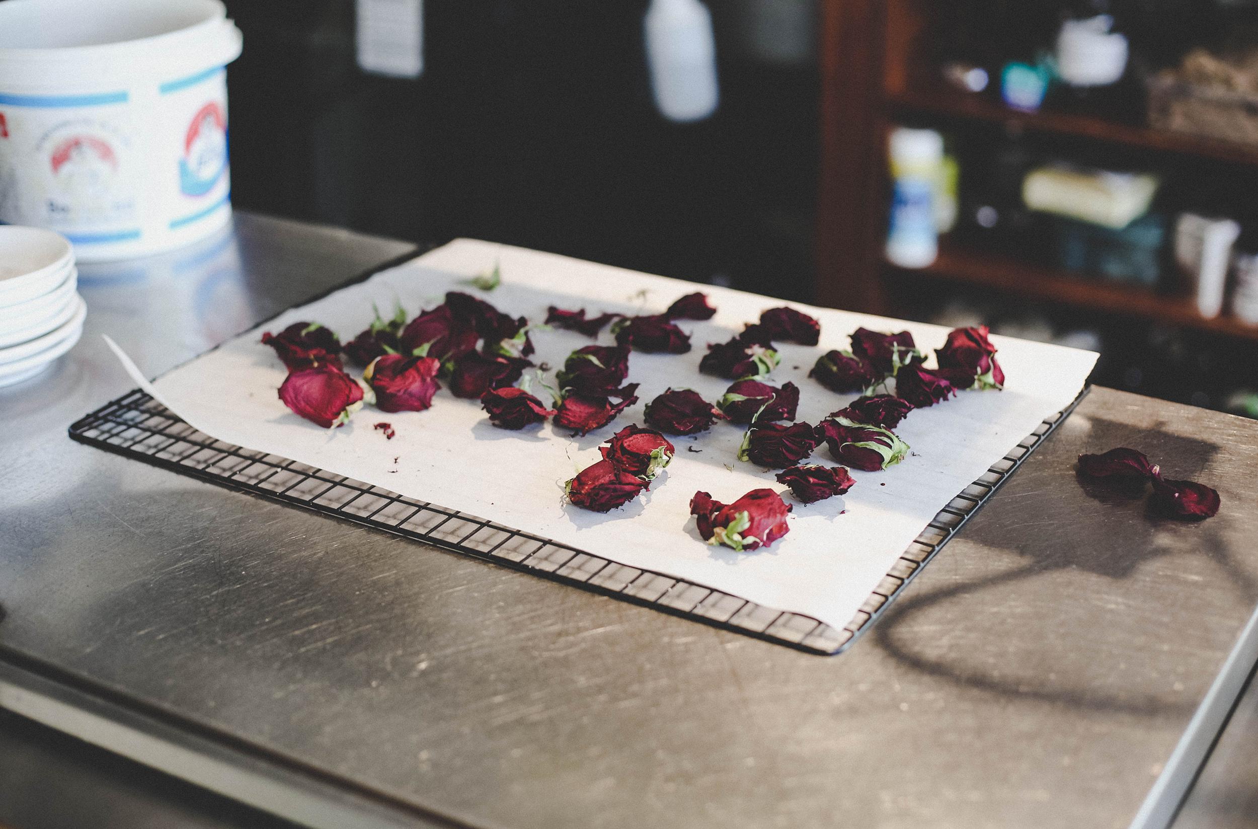 The process of drying roses. The petals are used in cocktails and desserts.