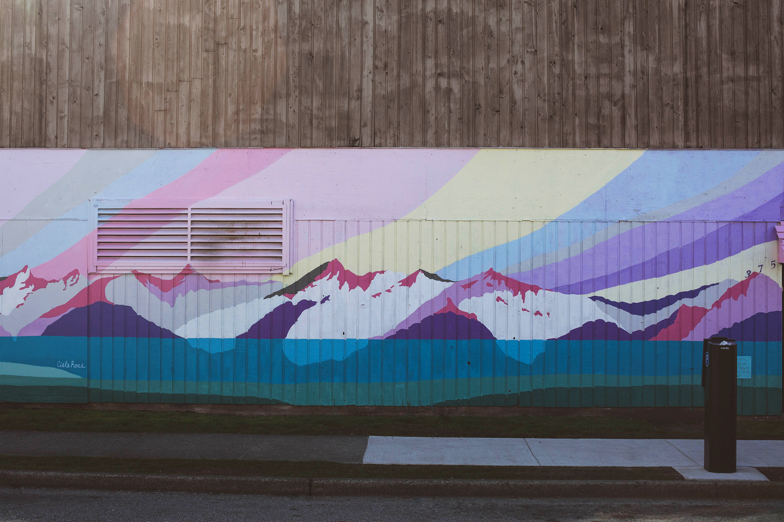 The mural wrapping the building is by local artist Ciele Rose.