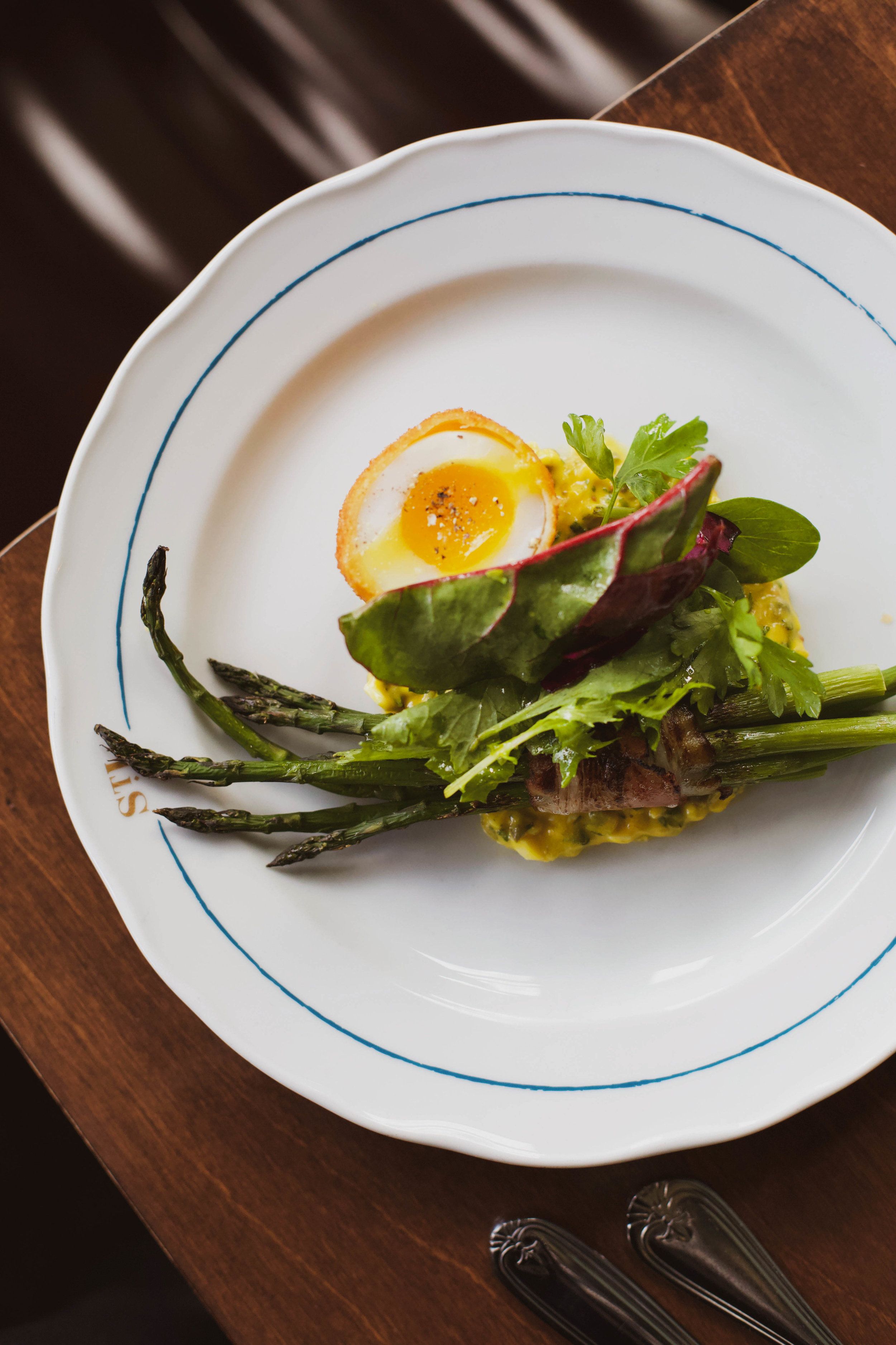 bacon-wrapped asparagus, duck egg, and  sauce ravigote