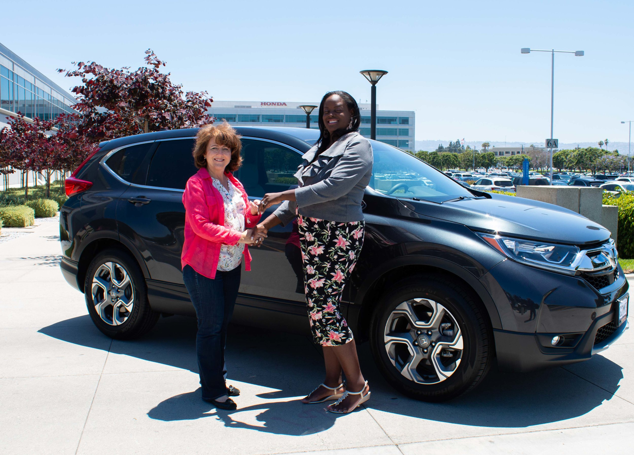 Francis Thompson with Teresa Phillips, Corporate Relations, American Honda