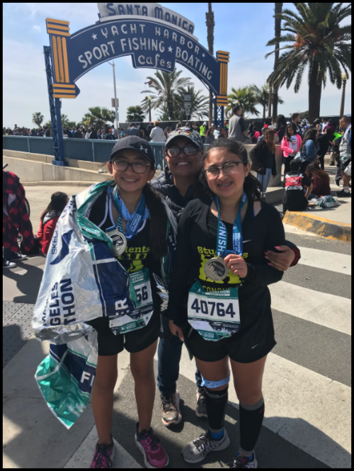 My first marathon with my sister and I.