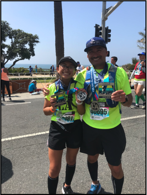 My dad and I at my 2nd marathon right after we crossed the finish line. I PR'd!