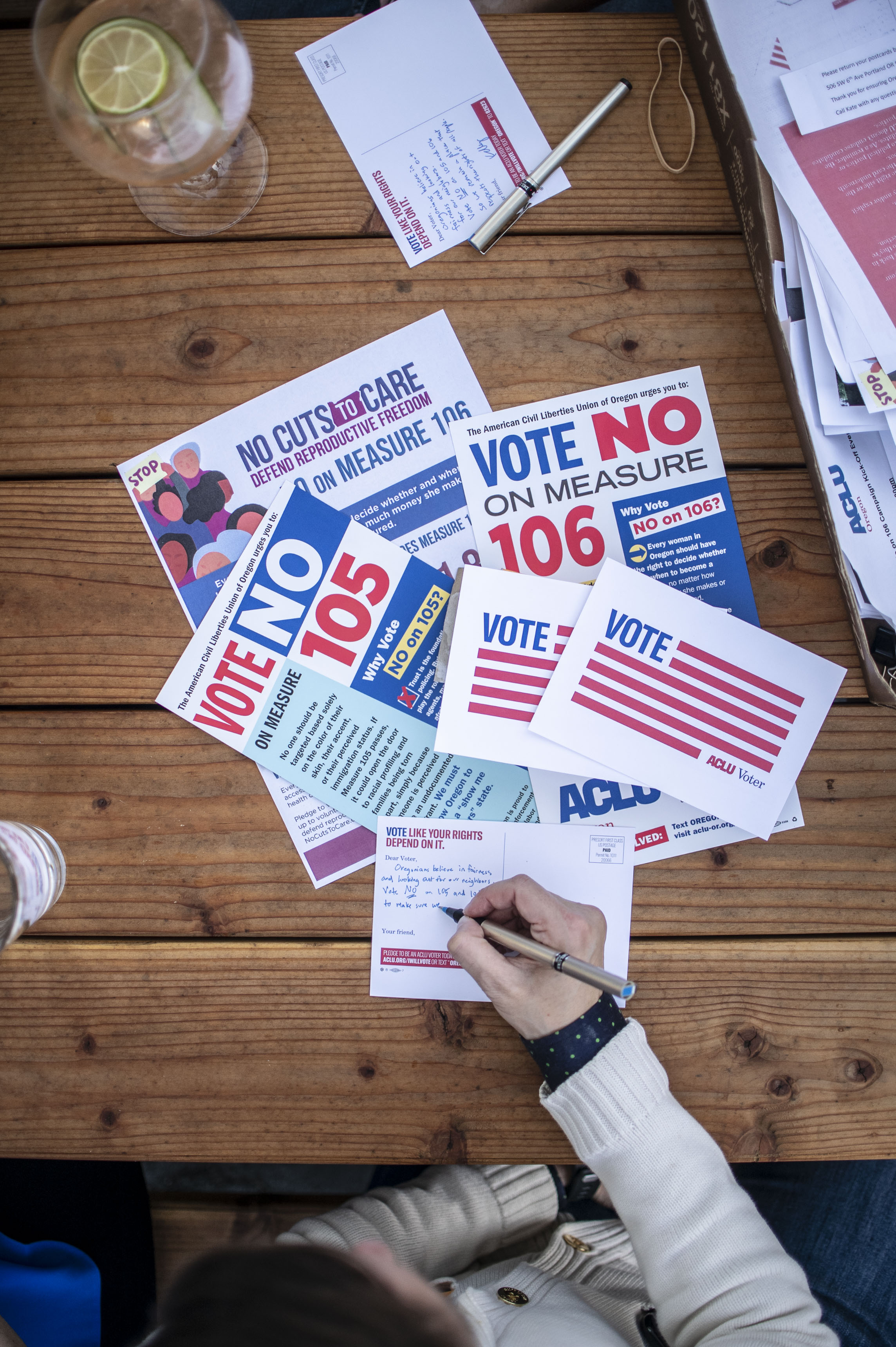 ACLU of Oregon supporters write No on 105 and No on 106 postcards to voters.