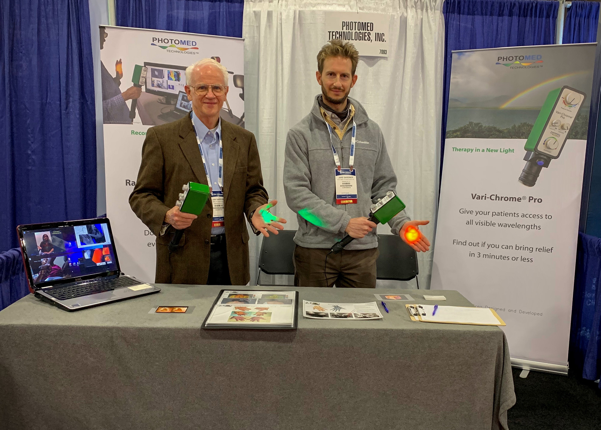 Allan and Jake Gardiner at PhotoMed's booth at the A4M conference in Las Vegas. Visitors got a hands-on demonstration of the Vari-Chrome® Pro.