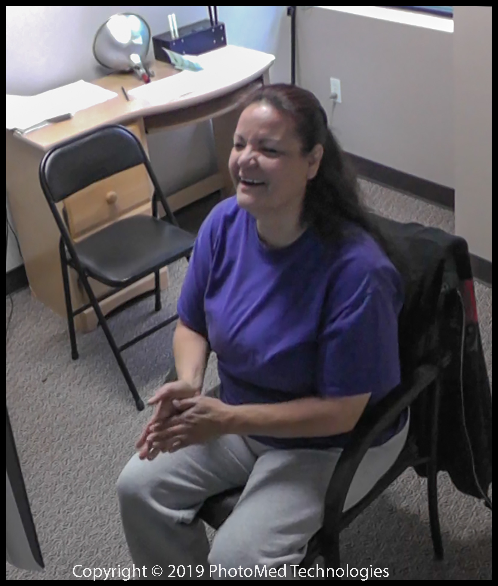 Brenda is surprised to feel her right hand fingers after surgery to her right elbow more than a year prior. No one anticipated this event. The therapy aimed to relieve pain, which was only partially relieved. This image is from a real-time video of the visit.