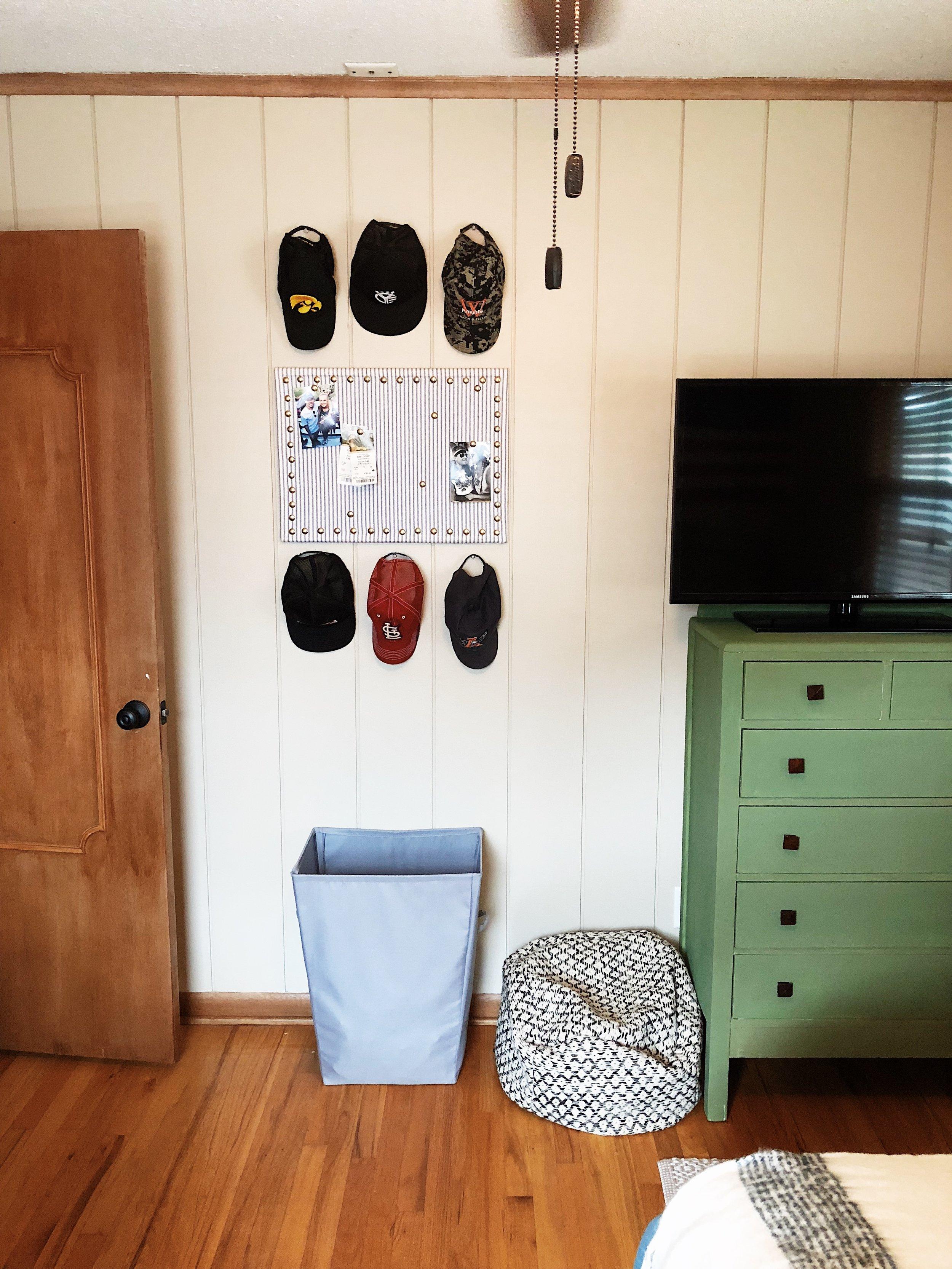 bedroom-college-guy-hats-dresser-apartment.jpg