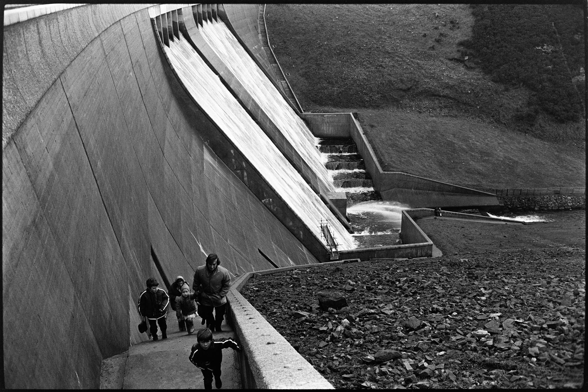 Water cascading over reservoir wall, Meldon. Documentary photograph by James Ravilious for the Beaford Archive © Beaford Arts