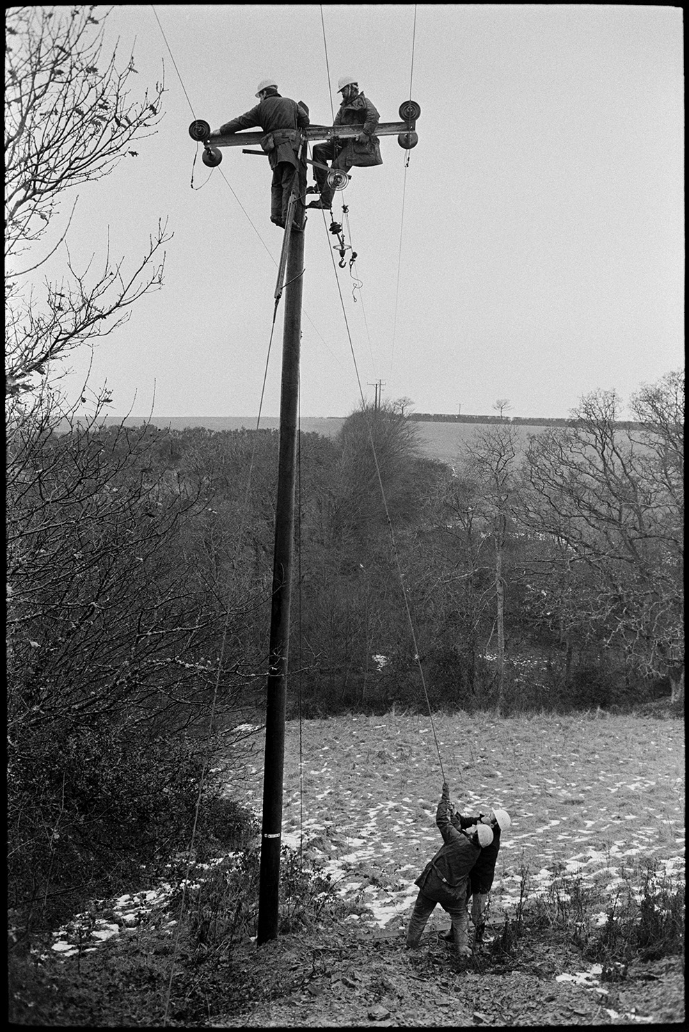 Electricity Board engineers putting up new power cables to village, Dolton,  2 January 1979.