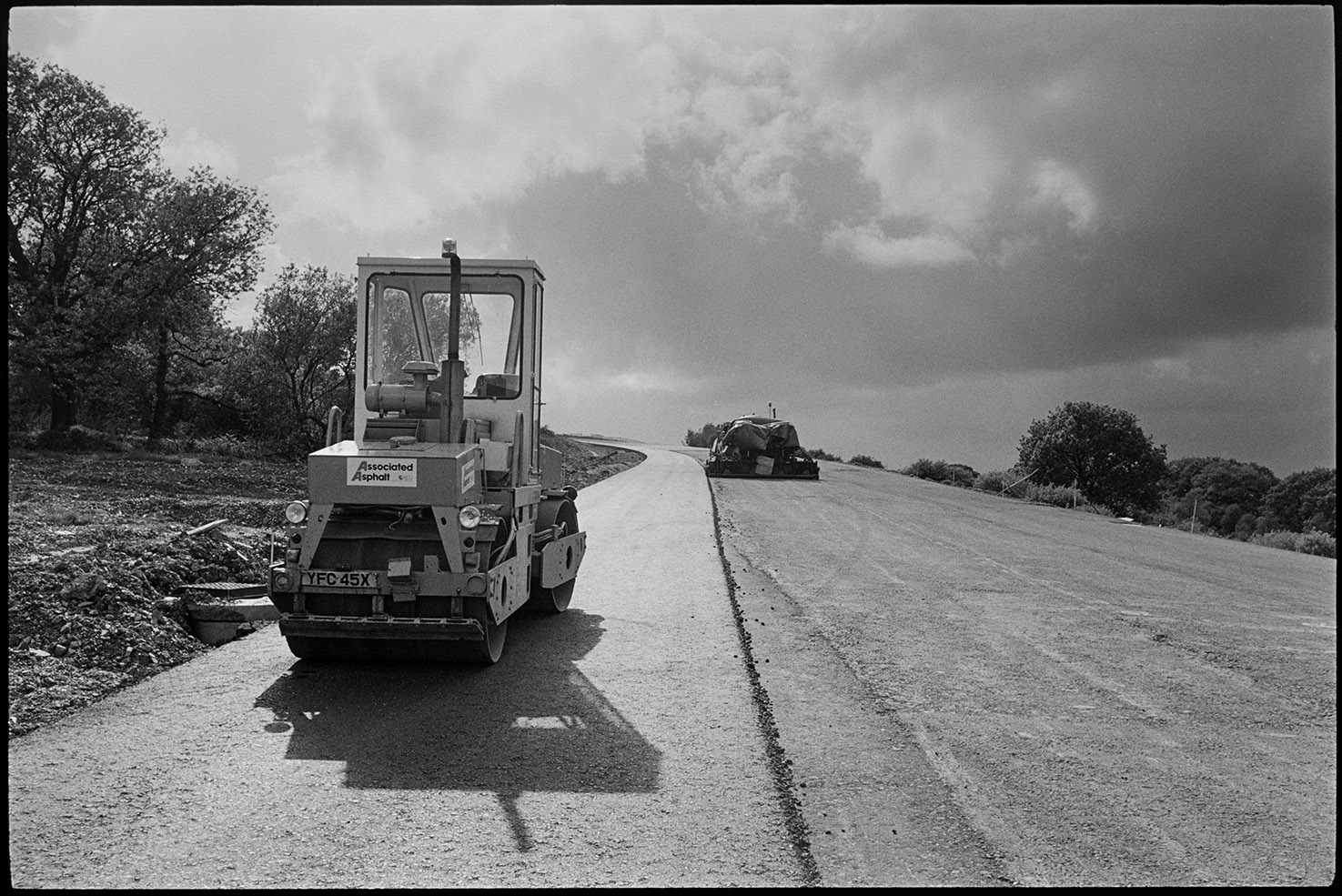 Machinery on new motorway link road shortly before it opened, diesel roller & earth mover, near Rackenford, August 1988.