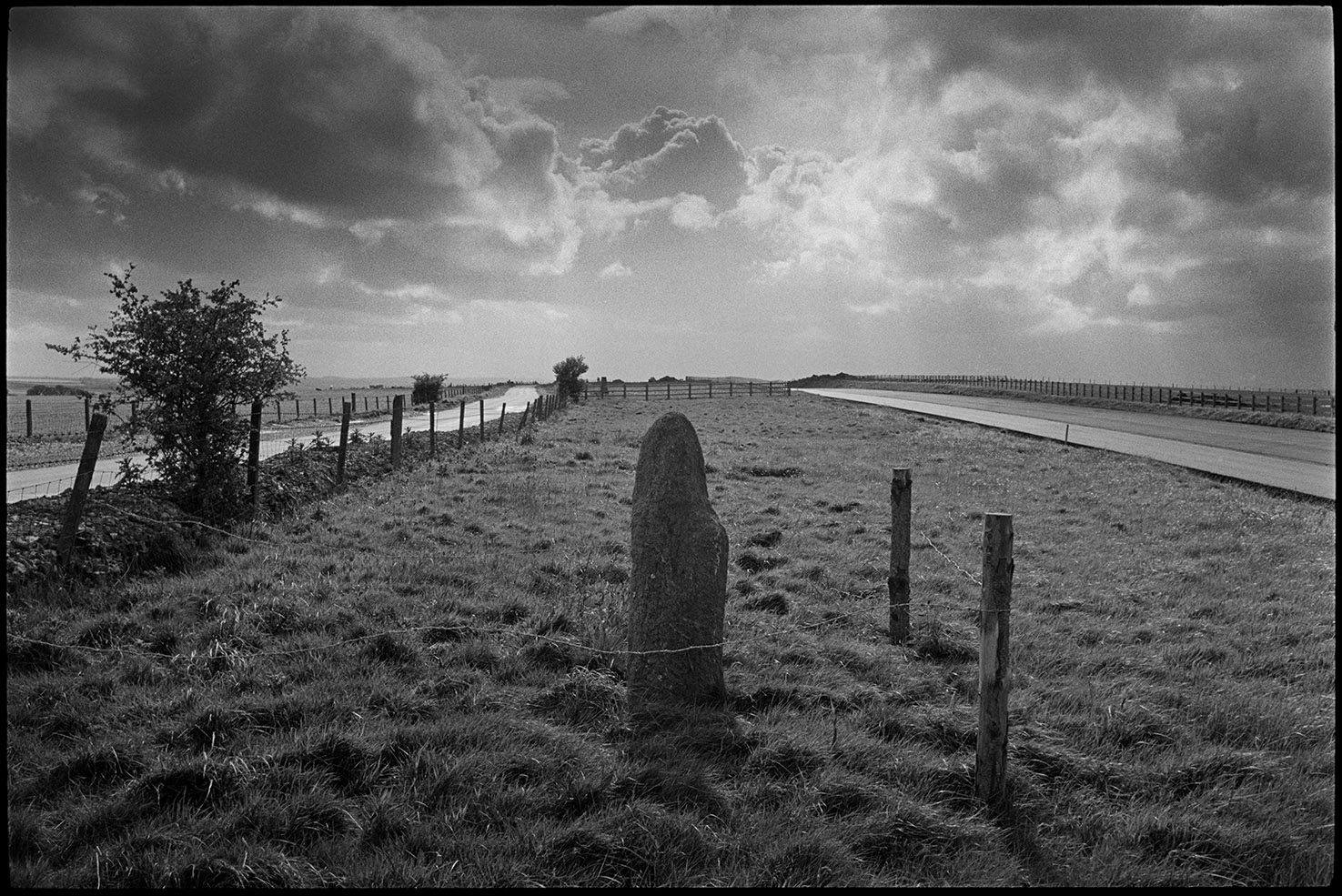 Standing stone beside new road it was moved before the road was laid down, near Rackenford, June 1988