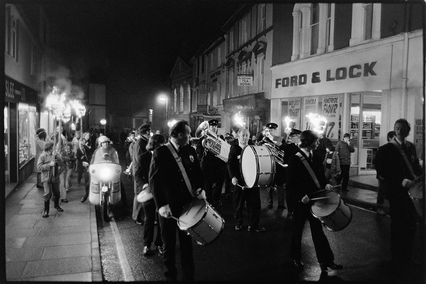 Street scene with torch bearers, Torrington, 2 November 1974