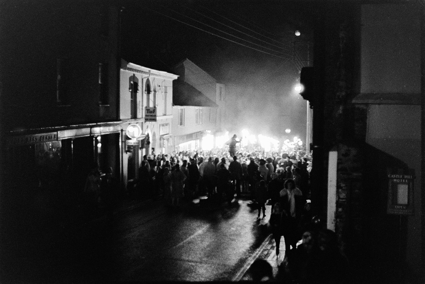 Wide angle street scene with torch bearers, Torrington, 2 November 1974