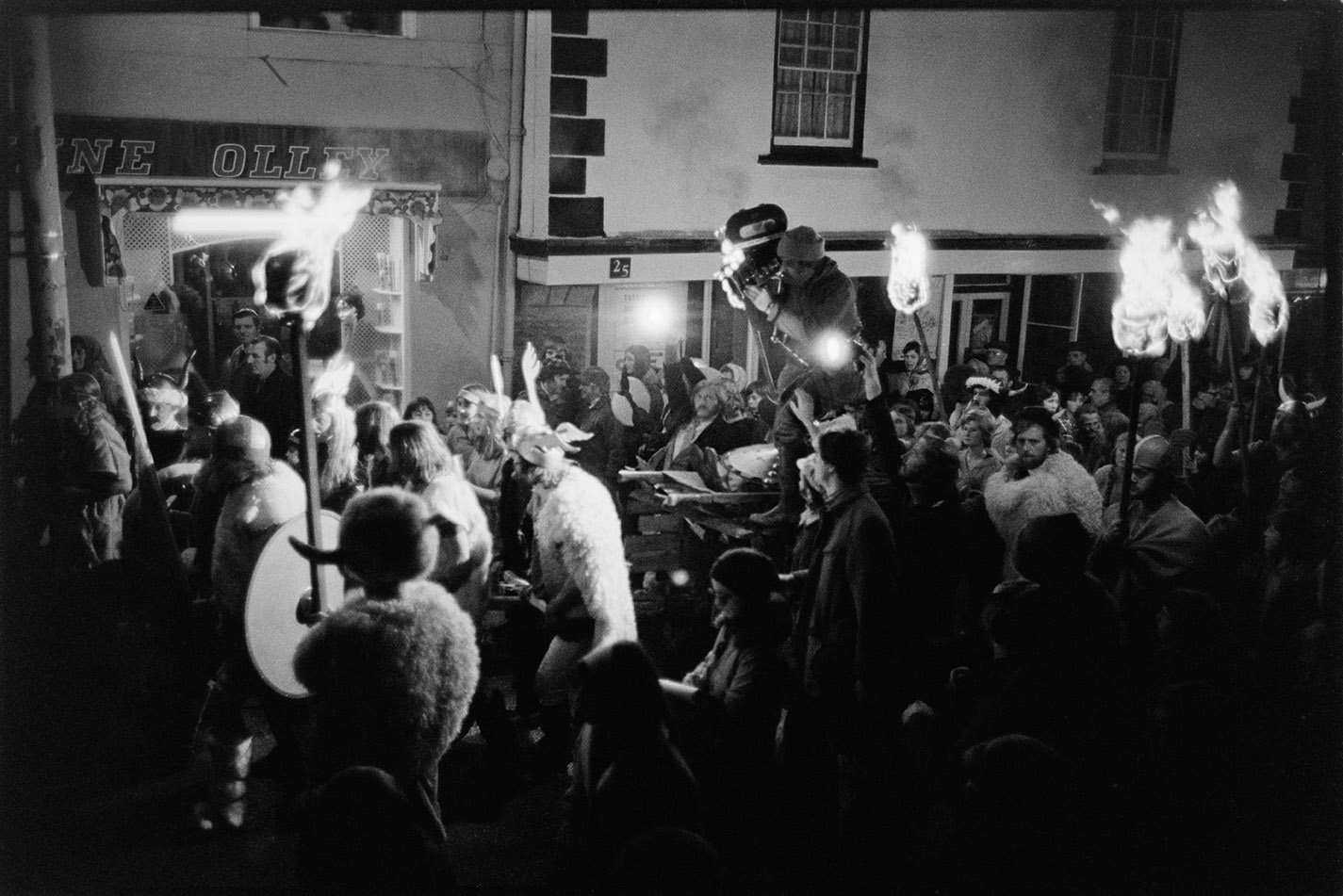 Cameraman held aloft - filming events, Torrington Fair, 2 November 1974