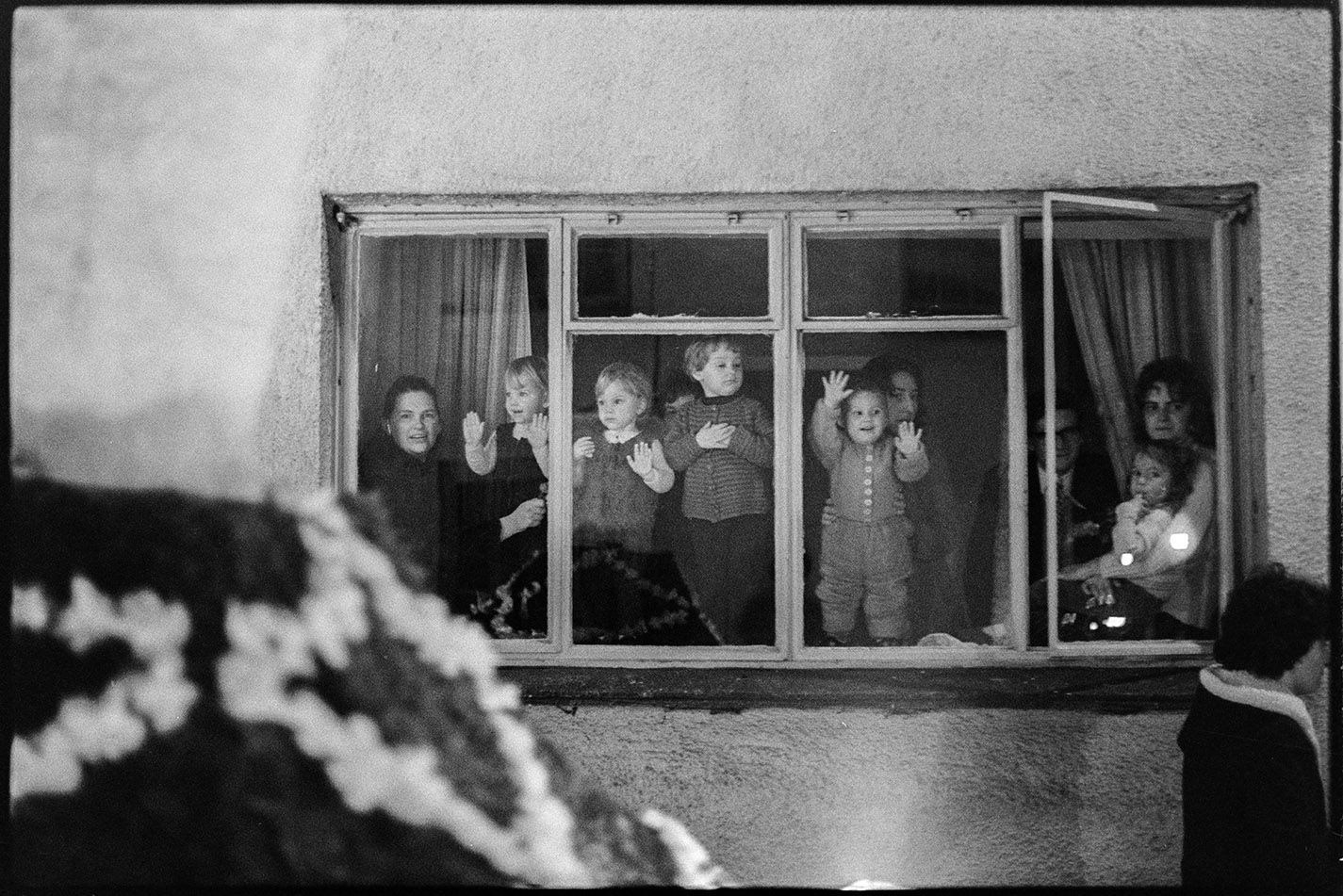 People watching night procession from window, Hatherleigh, 6 November 1974