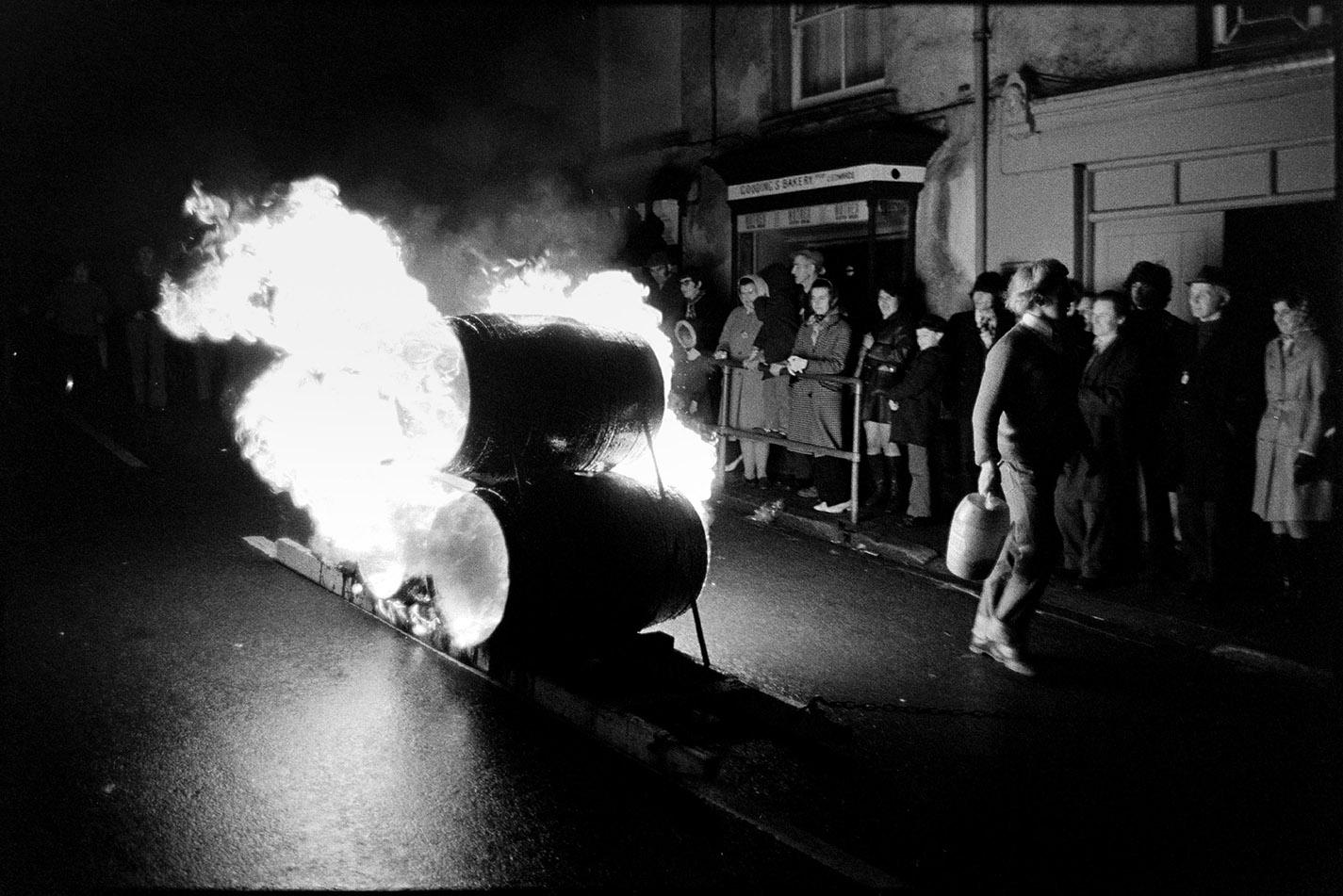 Burning tar barrels being pulled through the street at night, Hatherleigh, 6 November 1974