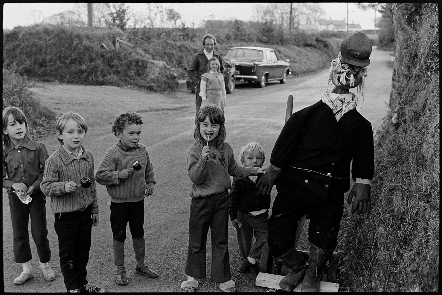 Guy in village street with children - Guy Fawkes, Ashreigney, October 1975