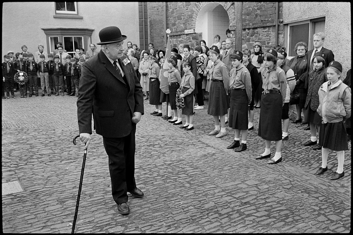 Men & women assembling for Remembrance Sunday Parade.  Chulmleigh, November 1981