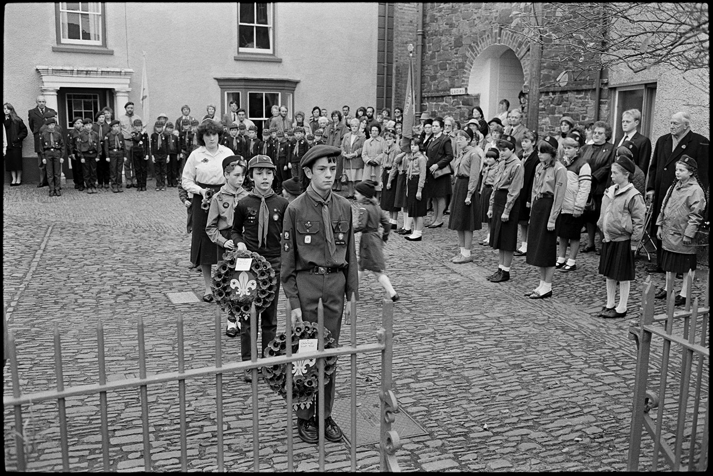 Parade at Memorial, laying wreaths by boy scouts.  Chulmleigh, November 1987