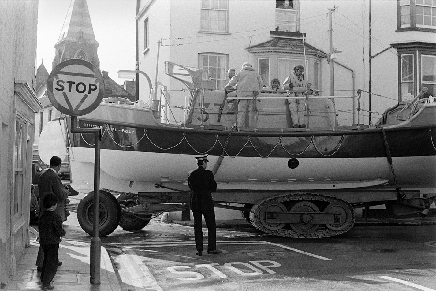 Lifeboat through town. Documentary photograph by Roger Deakins for the Beaford Archive © Beaford Arts