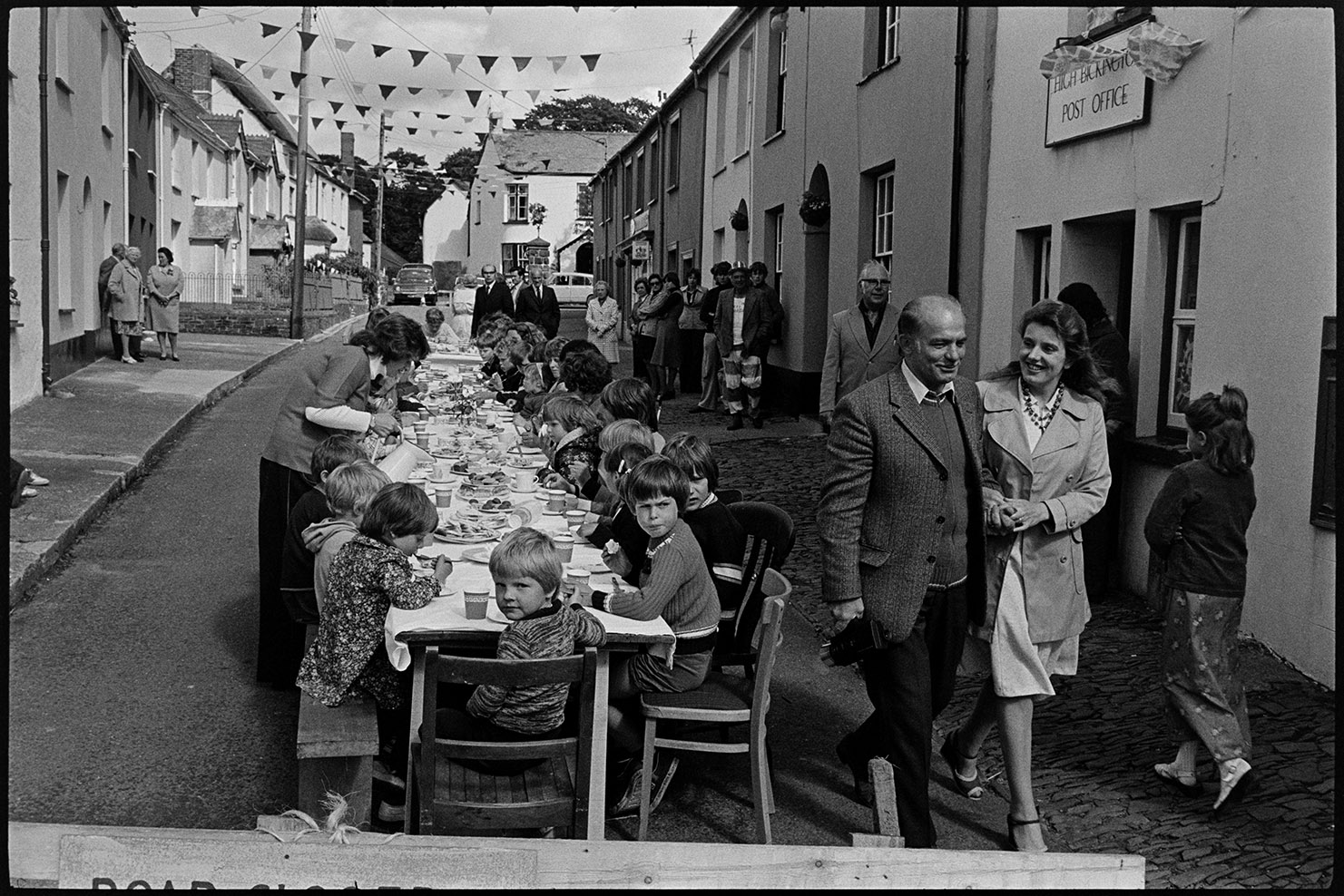 Children's tea in village street, Jubilee time, High Bickington, June 1977. Documentary photograph by James Ravilious for the Beaford Archive © Beaford Arts
