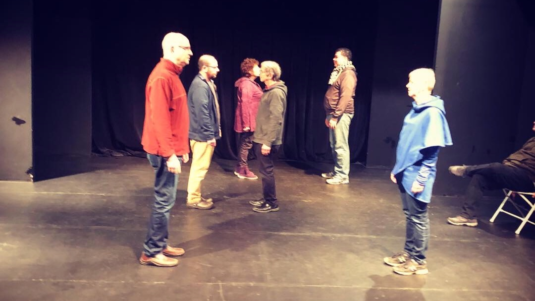 Members of a Bright Invention improv class doing an exercise called First Crossing.