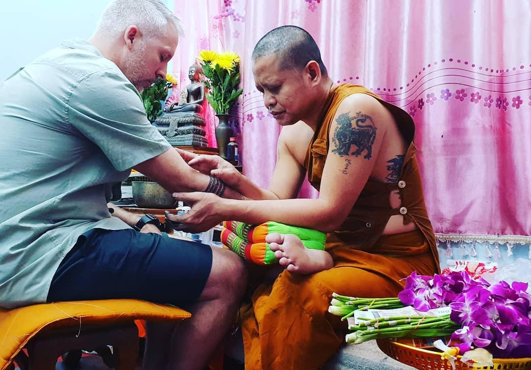 Phra Ajarn Bpom-Buddhist monk blessing a Sak Yant tattoo