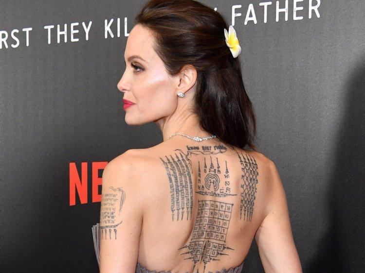 Angelina Jolie Sak Yank 5 line Tattoo and more.