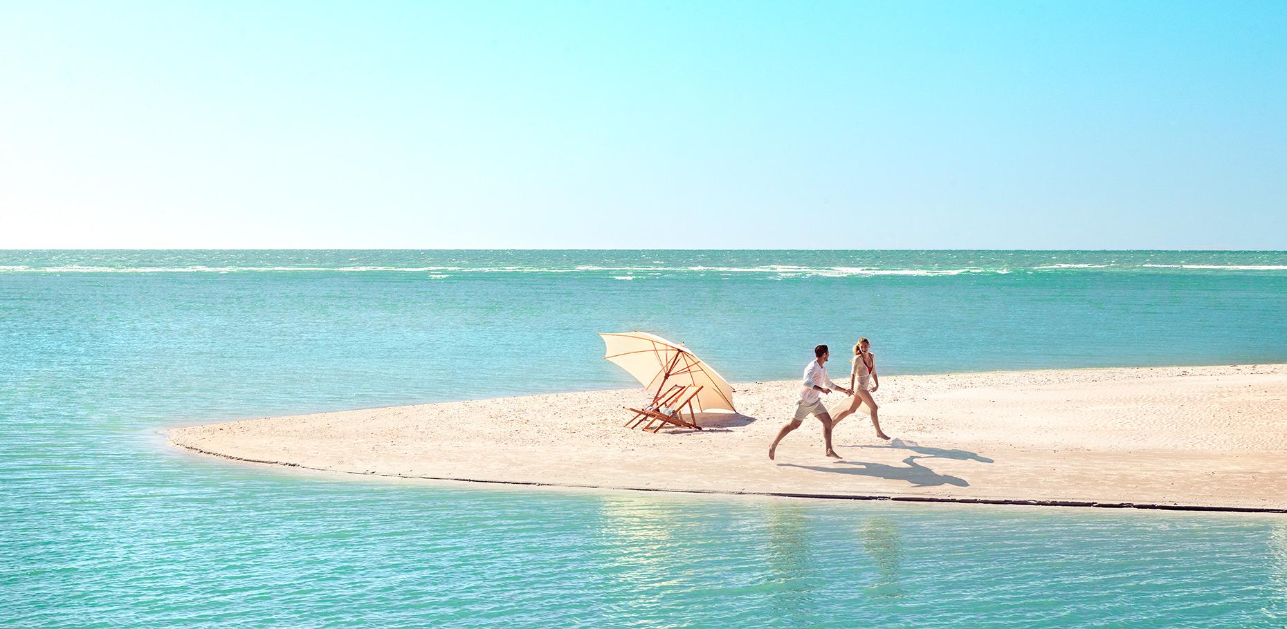 COUPLE.RUNNING.BEACH.jpg