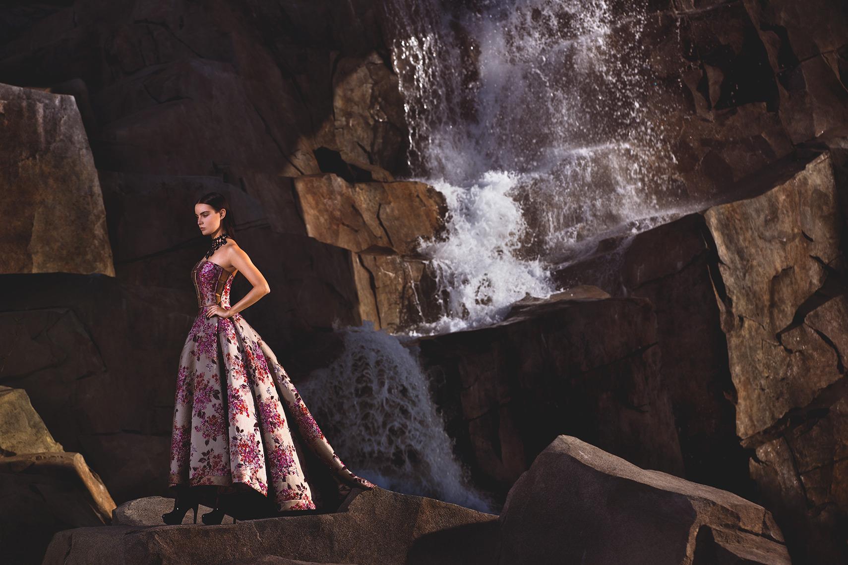 Model posing near a waterfall at the Pegasus World Cup Invitational