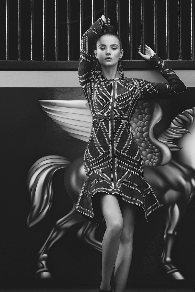 Model posing by stable wall at the Pegasus World Cup Invitational