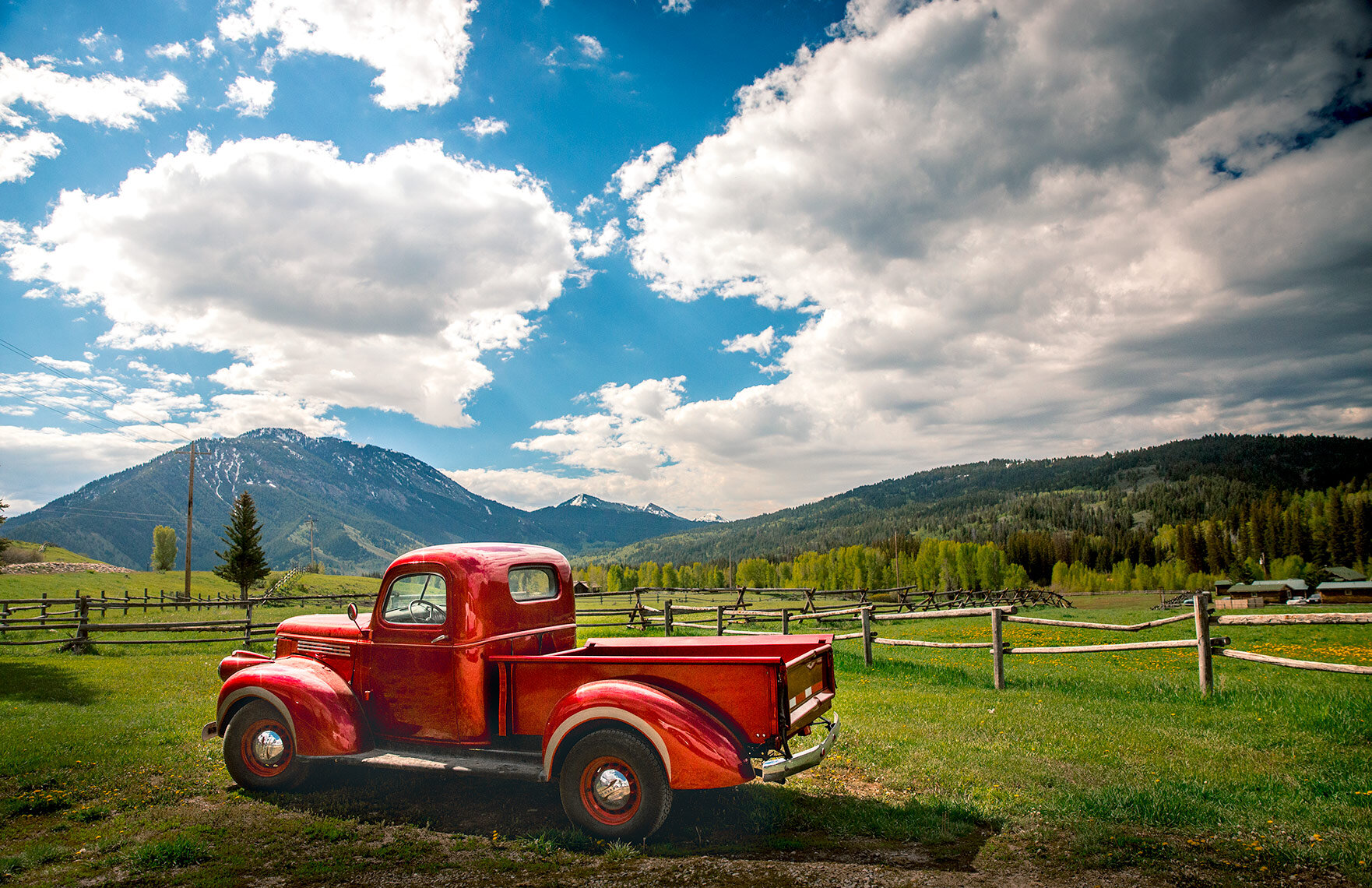 American West Photographer: Red truck on a farm.